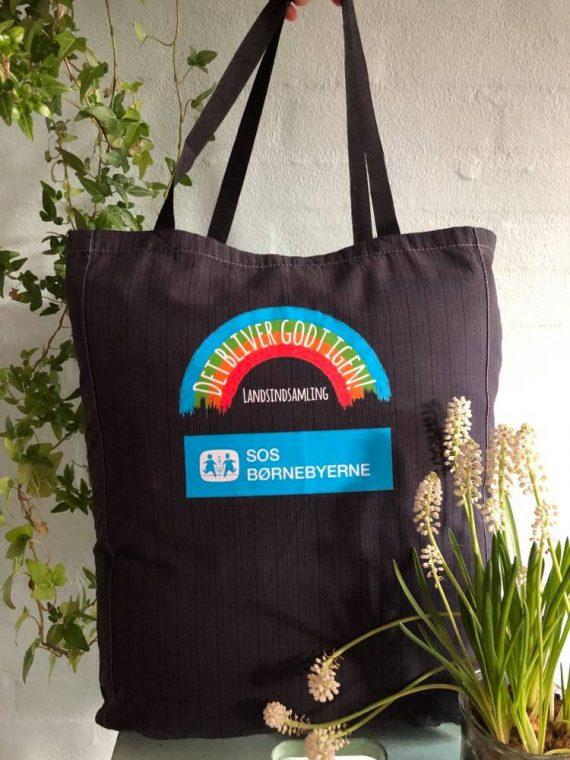 Lækker mulepose med regnbue og logo